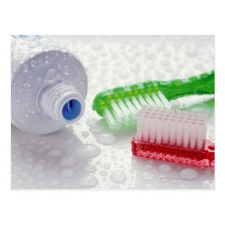 Close-up of toothpaste and toothbrushes covered postcard