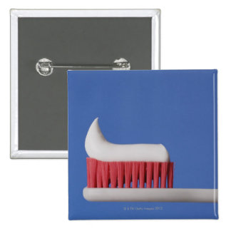 Close-up of toothpaste on a toothbrush 15 cm square badge