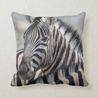 Close-up of zebra head between two other zebras cushion