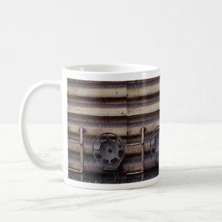 Close-up, rusted train car coffee mug