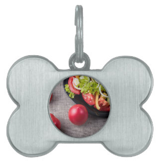 Close-Up top view fresh tomatoes and salad Pet ID Tag