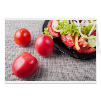 Close-Up top view on fresh tomatoes and a bowl Card