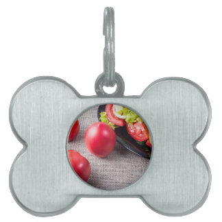 Close-Up top view on fresh tomatoes and a bowl Pet ID Tag