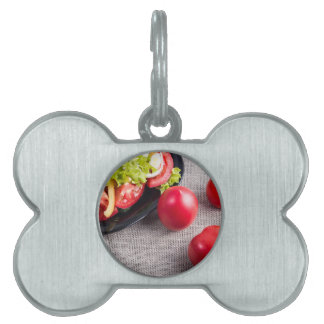 Close-Up top view on fresh tomatoes and a bowl Pet ID Tags