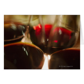 Close-up view of red wine glasses card