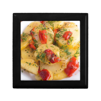 Close up view on a vegetarian dish of potatoes small square gift box