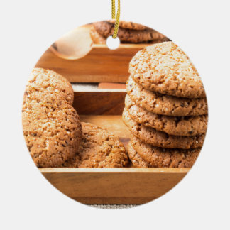 Close-up view on oat biscuits in wooden boxes ceramic ornament