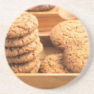 Close-up view on oat biscuits in wooden boxes coaster