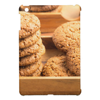 Close-up view on oat biscuits in wooden boxes cover for the iPad mini