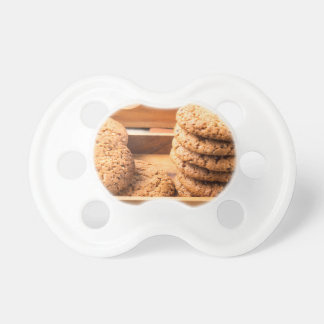 Close-up view on oat biscuits in wooden boxes dummy