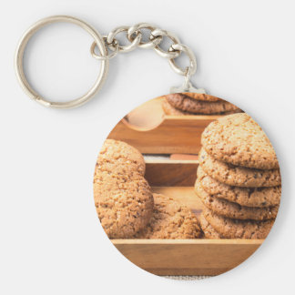 Close-up view on oat biscuits in wooden boxes key ring