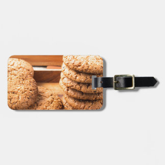Close-up view on oat biscuits in wooden boxes luggage tag