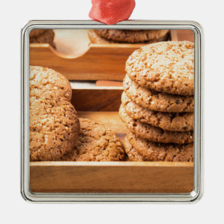 Close-up view on oat biscuits in wooden boxes metal ornament