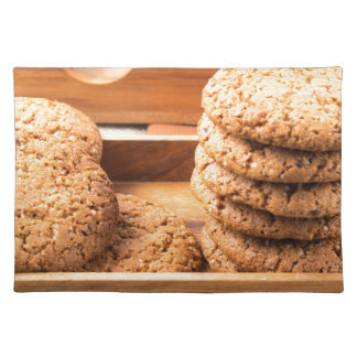 Close-up view on oat biscuits in wooden boxes placemat