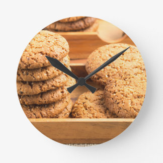 Close-up view on oat biscuits in wooden boxes round clock