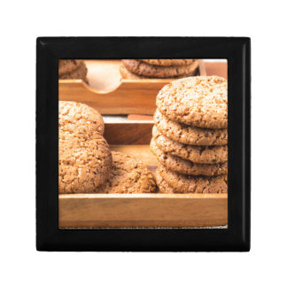 Close-up view on oat biscuits in wooden boxes small square gift box