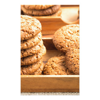 Close-up view on oat biscuits in wooden boxes stationery