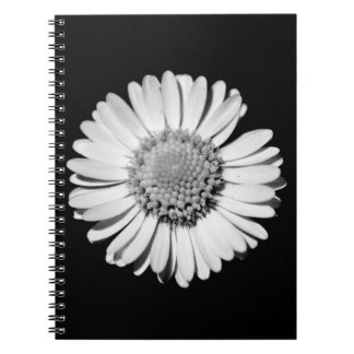 Closed-up black and white daisy spiral notebook