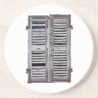 Closed window with old wood shutters coaster