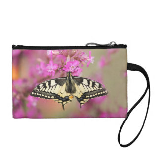 Closeup dovetail butterfly on lilac flower coin purse