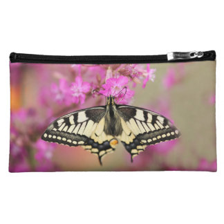 Closeup dovetail butterfly on lilac flower cosmetic bag