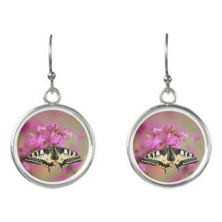 Closeup dovetail butterfly on lilac flower earrings