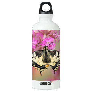 Closeup dovetail butterfly on lilac flower SIGG traveller 0.6L water bottle