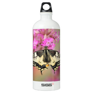 Closeup dovetail butterfly on lilac flower SIGG traveller 1.0L water bottle