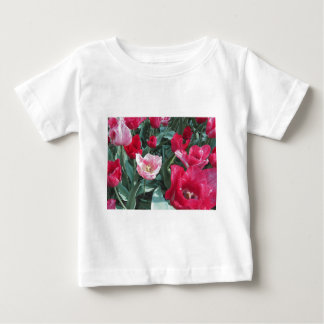 Closeup of colorful tulips with droplets in spring t shirt