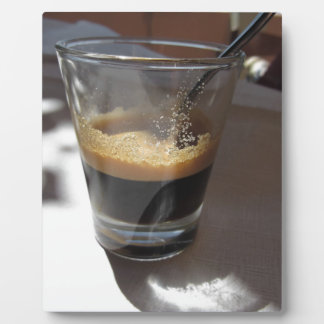 Closeup of espresso coffee in a glass cup photo plaques