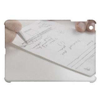 Closeup of hands signing prescription iPad mini cases