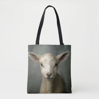 Closeup of new born lamb with grey background. tote bag