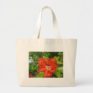 Closeup of red pomegranate flower large tote bag