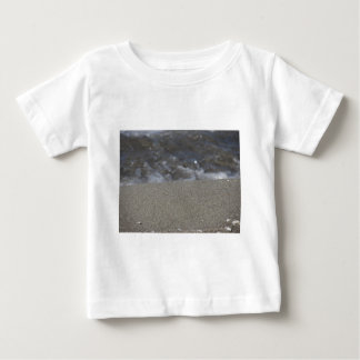 Closeup of sand beach with sea blurred background baby T-Shirt