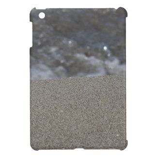Closeup of sand beach with sea blurred background cover for the iPad mini