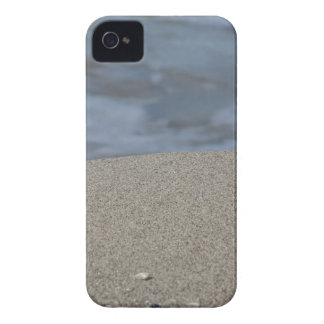 Closeup of sand beach with sea blurred background iPhone 4 cover