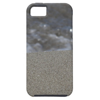Closeup of sand beach with sea blurred background iPhone 5 cases