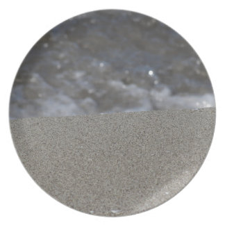 Closeup of sand beach with sea blurred background party plate