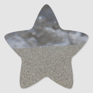 Closeup of sand beach with sea blurred background star sticker