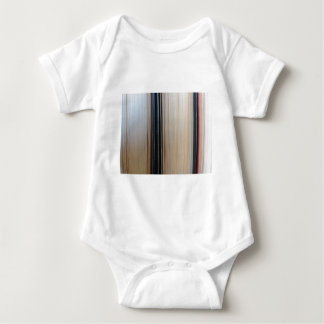 Closeup of second hand books standing on a table baby bodysuit