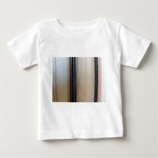 Closeup of second hand books standing on a table baby T-Shirt