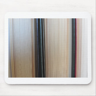 Closeup of second hand books standing on a table mouse pad