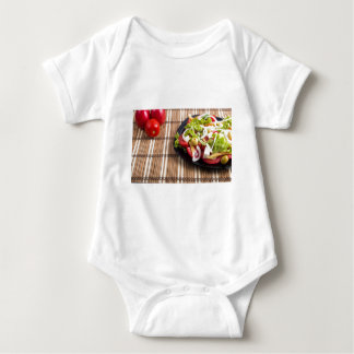 Closeup view fresh natural salad with raw tomato baby bodysuit