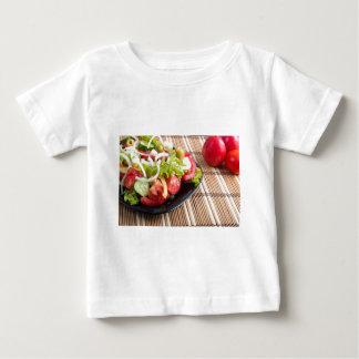 Closeup view fresh natural salad with raw tomato baby T-Shirt