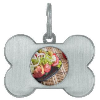 Closeup view fresh natural salad with raw tomato pet name tag