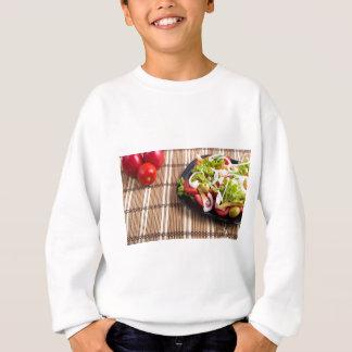 Closeup view fresh natural salad with raw tomato sweatshirt