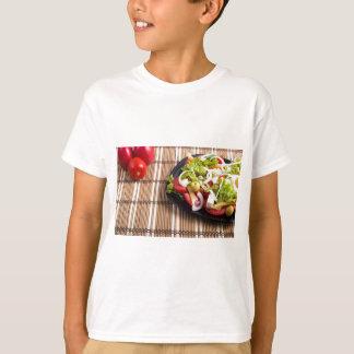 Closeup view fresh natural salad with raw tomato T-Shirt