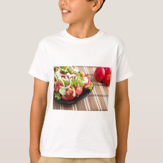 Closeup view fresh natural salad with raw tomato T-Shirt