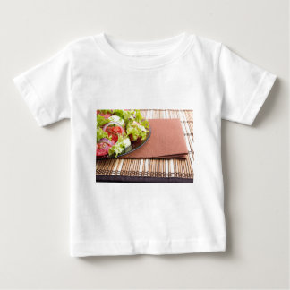 Closeup view of a plate with fresh salad of raw baby T-Shirt