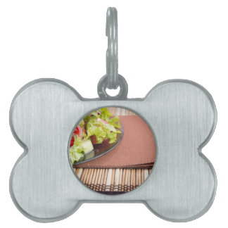 Closeup view of a plate with fresh salad of raw pet tag
